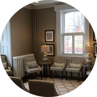 Dental lobby with soft lighting and gray chairs